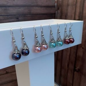 Four pairs of pearl earrings